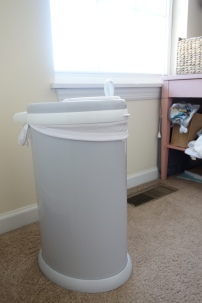 This is our Ubbi diaper pail. The diaper pail liner is reusable; I simply throw it in with the diapers when I take them down to the wash. When I change JP's diaper, whether it's poop or pee, I throw the whole diaper into the pail. You can only do this if your baby is exclusively breastfed - breastmilk is water soluble. Once JP starts solids, I will have to dump the fecal fun into the toilet, then put the diaper into the pail.